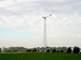 Small wind turbine helps power a rural farm operation.