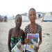 Women w/copies of the Bri Kouri Nouvèl Gaye popular newspaper featuring the internal displacement camp where they live.