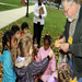 "CLC preschoolers enjoy a tour of the autumn leaves with CSM Professor Lee Vines, who is referred to as ""Leaf Man."""