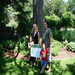 Beth Eckhardt, Eric Korbach and children, with their award-winning tree in Como neighborhood. Photo by Sharon Shinomiya
