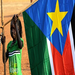 A young girl holds a flag signifying the recent independence of South Sudan