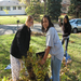 The Brooklyn Center High School Latino Club rakes leaves for seniors in the area.