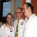 Congratulations! Bertil and Eric receive their RN pins. Mark (center) is their instructor.