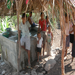 "Children gathered at the ""pila"" (the water storage unit that most family use for all their water needs)"