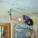 Scraping paint during the 2010 Puerto Rico Mission to reconstruct a youth community center