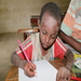 Jamalo begins to learn, he has never been to school before