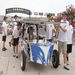 Team returns their solar car to the garage at Texas Motor Speedway