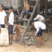 Spitler School Children perform community service by collecting trash from the village surrounding the school