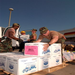National Guard helping distribute food to those in need after Hurricane Katrina.