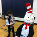 Simone, as Dr. Seuss, reads The Cat in the Hat.