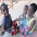 Students play with a donated hand made stuffed animal.