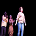 A young writer takes her bow after the professional actors behind her perform her original play.