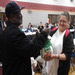 Community member receives a free turkey at our Pre-Thanksgiving Dinner.