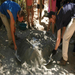 Mixing cement for the latrines.