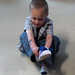 This child was so excited about his new sneakers that he put them on right away!