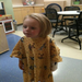 Tiny Teeja in her big hospital gown in the first days of her diagnosis.