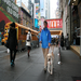 A Seeing Eye instructor training a yellow Labrador retriever in Times Square, New York City.