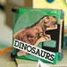 Cool dinosaur scrapbook made from old floppy disks and an old magazine.