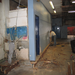 Demolition of the old rest rooms to make way for bigger and handicapped accessible rest rooms.