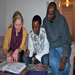 Youthlinc volunteer provides basic literacy lesson to refugee family.