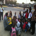 Teaching kids at a bus stop in south Dallas