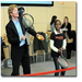 Jim Courier gives tennis lesson to Tenacity student.