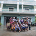 [group photo in front of the main building of the Learning Center]