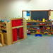 Our welcoming playroom, with dress up, trucks, dinosaurs, and more...