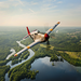 "P-51C Mustang ""Tuskegee Airmen"" in a flyover of the Mississippi River"