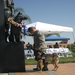 Military Dog Handler with his K-9 partner paying respects to the Museum's War Dog monument