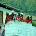 Children in the Community Watch the Work from a Nearby House in San Antonio de Alao, Ecuador 2011
