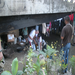 Delivering meals to families who live under a bridge in Ocho Rios.