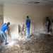 Volunteers gutting, removing damged drywall