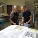Master printer Cole Rogers works with visiting artist Carter on a series of new prints.