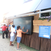 Children feeling the heat from the Solar Air Heat Panels on our Tiny Solar House