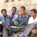 A group of boys in Ethiopia enjoy a new book together.