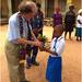 BFA founder Tom Warth greets a student in Nigeria.