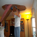 Volunteer repair damaged ceiling from tornado and add new insulation