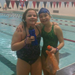Ally after 94 laps completed in her two hour swim-a-thon. Still smiling with her friend Libby!