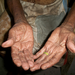 An elder midwife's hands. Our midwife project works to strengthen natural healing practices in the region.