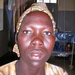 This woman was repeatedly raped by the LRA soldiers and now must raise a child from that experience.