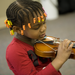 Prelude Preschool student learns the violin