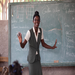 Dilaine Gilles teaches children in the Accelerated Education program - many of whom were once household slaves.