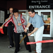 Representative Cheryl Rivera and Major Sarno cut the ribbon