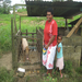 Temalesi Tarai with her daughter.  Temalesi used her loan to buy 2 piglets and supplies for her small canteen business.