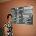 Ilaisane Taloa stands proud in front of the menu of her restaurant (Tonga)
