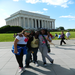 Arieona, Charnishia, and Anjonae pose at the Lincoln Memorial