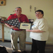 Author/Veteran presents flag at the Meekins Library