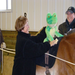 Wendy & Kathy help to position Froggy on Lily in a mock treatment session.