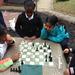 Relaxing with a game of chess at recess.